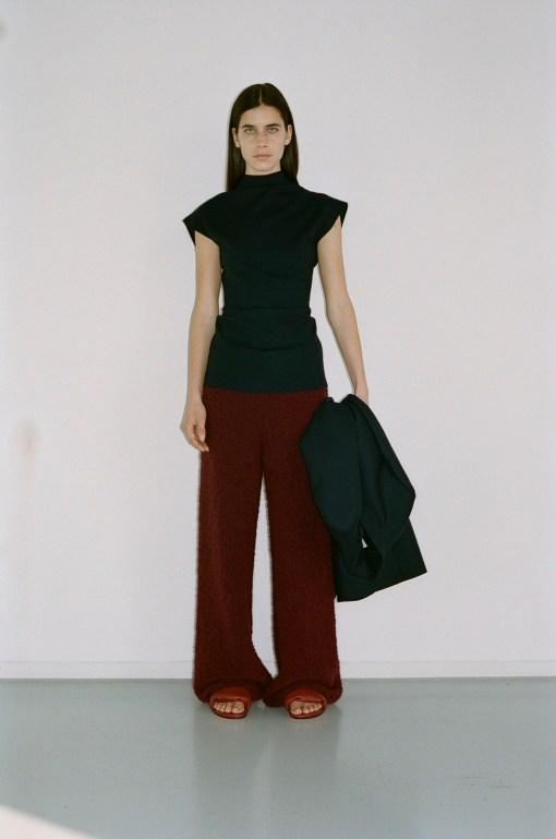 GAUCHERE Fall Winter 2021 Paris Fashion Week LOOK 9 Coat THEDA, Top TOTIE, Knit Trousers THIEN, Shoes PILLOW