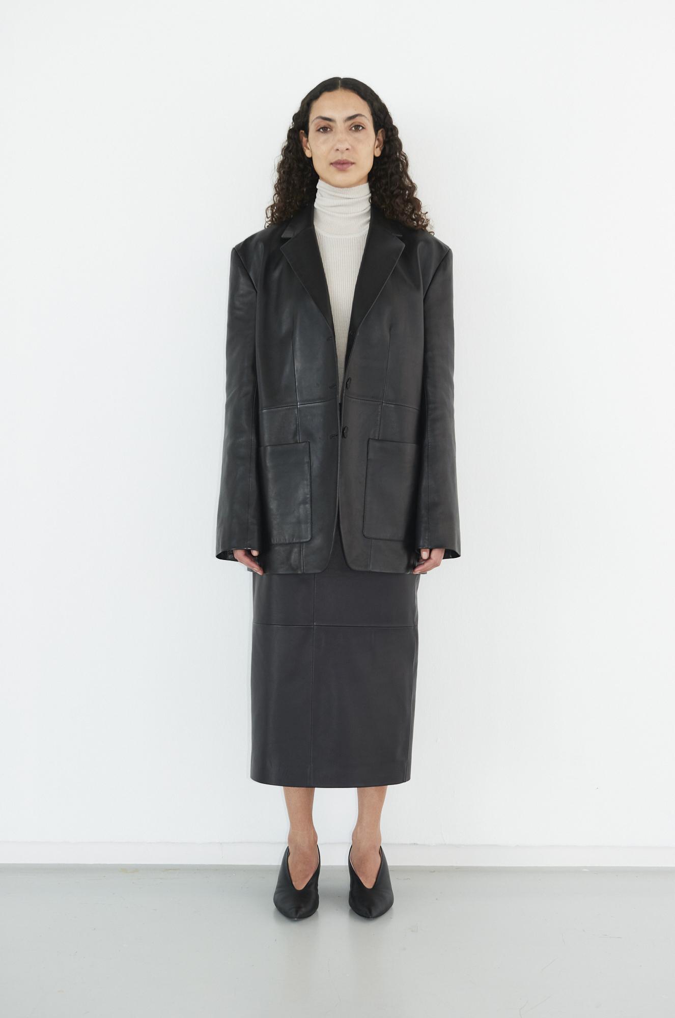 GAUCHERE Fall Winter 2021 Paris Fashion Week LOOK 13 Jacket TYRON, Knit Top TULA, Skirt TWILA, Shoes PILLOW PUMP